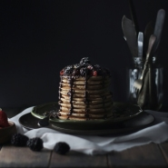 Whole wheat yogurt pancake w/ berries & choco sauce